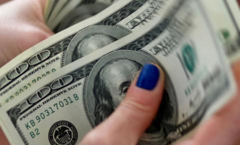Dólar cai para R$ 5,56 com ambiente externo positivo